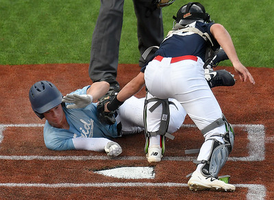 Enid Plainsmen's Garrett Shull is tagged out at home by Woodward's Connor Thompson Thursday, June 4, 2020 at David Allen Memorial Ballpark. (Billy Hefton / Enid News & Eagle)