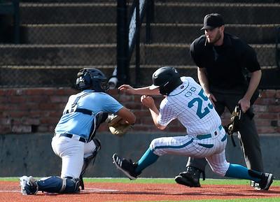 Enid Plainsmen's Garrett Brooks tags out Oklahoma Drillers' Brady Friesen at home plate Tuesday, June 2, 2020 at David Allen Memorial Ballpark. (Billy Hefton / Enid News & Eagle)