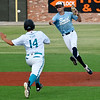 Enid Plainsmen's Maddux Mayberry throws around Oklahoma Drillers' Colton Robinson to complete a double play Tuesday, June 2, 2020 at David Allen Memorial Ballpark. (Billy Hefton / Enid News & Eagle)