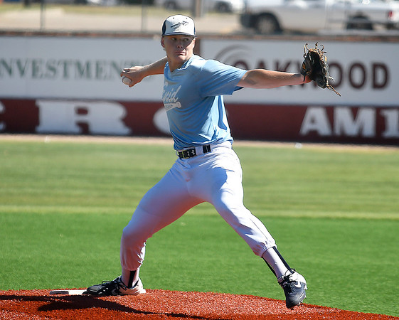 Enid Plainsmen's Tyler Holland delivers a pitch against Kingfisher Tuesday, June 23, 2020 at David Allen memorial Ballpark. (Billy Hefton / Enid News & Eagle)