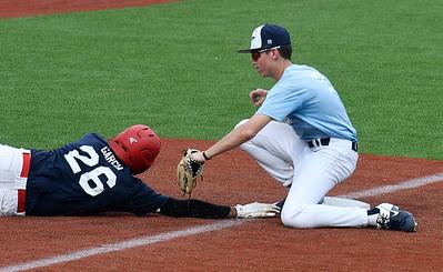 Enid Plainsmen's Jake Kennedy tags out Woodward's David Garcia after a rundown Thursday, June 4, 2020 at David Allen Memorial Ballpark. (Billy Hefton / Enid News & Eagle)