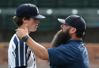 Enid Majors coach, Kris Webb, talks to pitcher, Kason Jackson, between innings against Weatherford Monday, June 1, 2020 at David Allen Memorial Ballpark. (Billy Hefton / Enid News & Eagle)