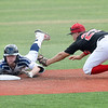 Enid Majors' Drake Kerr dives into second base ahead of the tag from Shockers Black's Drew Woods during the Connie Mack Regional Qualifier at David Allen Memorial Ballpark Saturday, June 20, 2020. (Billy Hefton / Enid News & Eagle)
