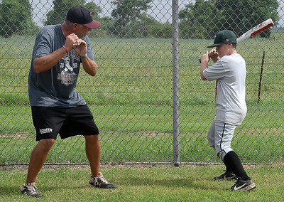 David Riesen gives so tips on batting stance to Gavin Huddleston during the Pioneer Baseball Camp Wednesday, June 9, 2021 at Pioneer High School. (Billy Hefton / Enid News & Eagle)