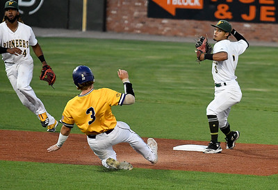 Western Oklahoma's Sammy De La Cruz throws over LSU Eunice's Jarrett McDonald for a double play during the NJCAA DII World Series Friday, June 4, 2021 at David Allen Memorial Ballpark. (Billy Hefton / Enid News & Eagle)