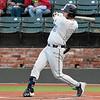 Madison CC's Gunnar Doyle gets a base hit against Kellogg CC during the NJCAA DII World Series at David Allen Memorial Ballpark. (Billy Hefton / Enid News & Eagle)