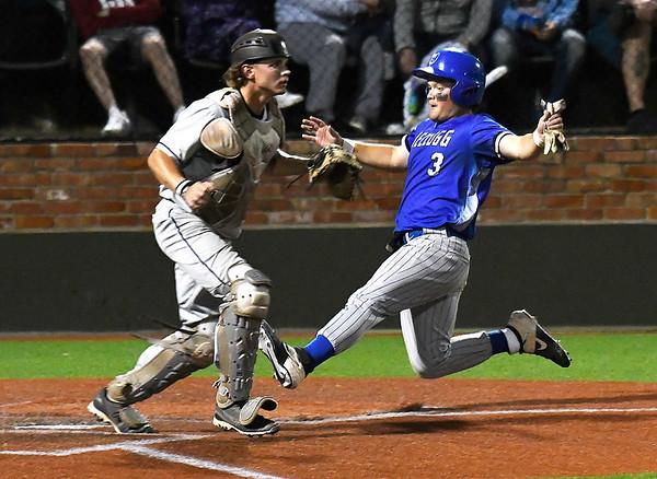 Kellogg CC's Connor Hnilo slides behind Madison CC's Kameron Laskowski during the NJCAA DII World Series at David Allen Memorial Ballpark. (Billy Hefton / Enid News & Eagle)