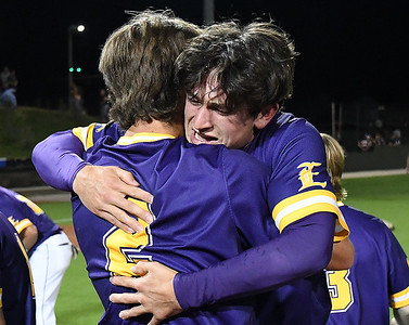 LSU Eunice's Jerry Couch hugs Kole Myers following their 5-4 win over Western Oklahoma in the championship game of NJCAA DII World Series Saturday, June 5, 20212 at David Allen Memorial Ballpark. (Billy Hefton / Enid News & Eagle)