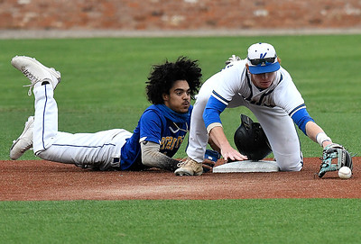Patrick Henry CC's Omar Gonzalez dives back into second base as the ball gets away from Kirkwood CC's Alex Pendergast during the NJCAA DII World Series at David Allen Memorial Ballpark. (Billy Hefton / Enid News & Eagle)