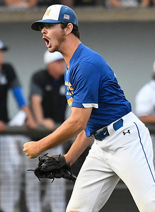 Patrick Henry CC pitcher, Jacob Matheney, lets out a yell after the final out against Kirkwood CC during the NJCAA DII World Series at David Allen Memorial Ballpark. (Billy Hefton / Enid News & Eagle)