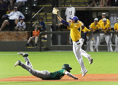 Western Oklahoma's Chayce Bryant dives into second base under LSU Eunice's Jack Merrifield during the NJCAA DII World Series June 3, 2021 at David Allen Memorial Ballpark. (Billy Hefton / Enid News & Eagle)