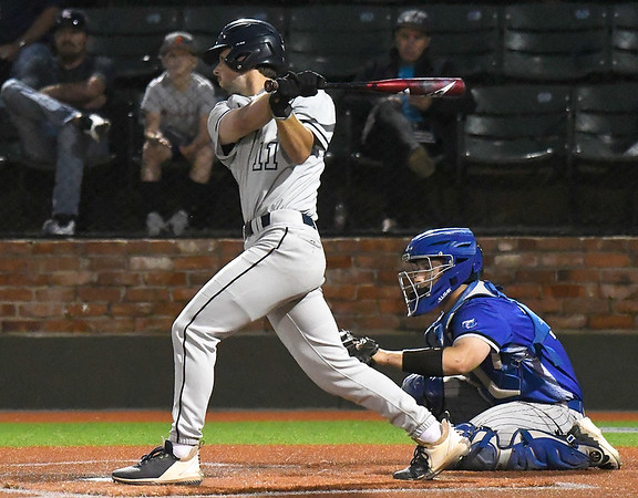 Madison CC's Jake Nelson hits a single against Kellogg CC during the NJCAA DII World Series at David Allen Memorial Ballpark. (Billy Hefton / Enid News & Eagle)