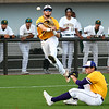LSU Eunice's Peyton Lejeune throws over Jerry Couch after fielding a bunt against Western Oklahoma during the NJCAA DII World Series Friday, June 4, 2021 at David Allen Memorial Ballpark. (Billy Hefton / Enid News & Eagle)