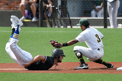 Patrick Henry's Taylor Reney slides into second as the ball gets away from Western Oklahoma's Sammy De La Cruz during the NJCAA DII World Series Wednesday, June 2, 2021 at David Allen Memorial Ballpark. (Billy Hefton / Enid News & Eagle)
