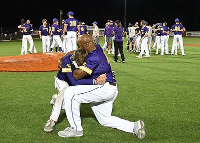 LSU Eunice's Beau Kirsch embraces coachm Roberto Vaz following their 5-4 win over Western Oklahoma to win the NJCAA DII World Series Saturday, June 5, 20212 at David Allen Memorial Ballpark. (Billy Hefton / Enid News & Eagle)