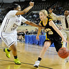 Alva's Jayna Hadwiger looks for an opening against Northeast's Jaelyn Coleman during the Lady Bugs 53-36 loss in the class 2A championship game Saturday at the State Fair Arena in Oklahoma City. (Staff Photo by BILLY HEFTON)