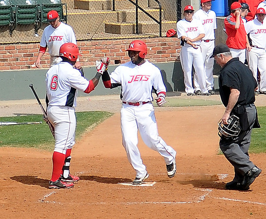 NOC-Enid Jets' A.J. Wilson (left) congratulates T.J. Turner as he crosses home plate after Turner blasted a home run in the bottom of the fourth inning against the Rose State Raiders at David Allen Memorial Ballpark Saturday, March 16, 2013. (Staff Photo by BONNIE VCULEK)