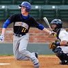 Stillwater's Luke Spencer heads to first after making contact against Enid in the opening game of the Gladys Winters Tournament Thursday at David Allen Memorial Ballpark in Enid. (Enid News & Eagle Photo by Billy Hefton)