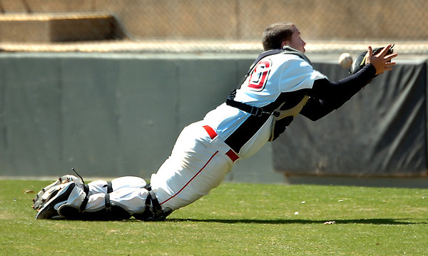 NOC-Enid catcher, Aaron McCandless, bobbles a pop foul behind home plate Tuesday against Dodge City at David Allen memorial Ballpark. (Staff Photo by BILLY HEFTON)