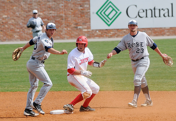 NOC-Enid's Chase Knott reacts after he is called out on a double-play at second by Rose State's Garrett Crain Saturday, March 16, 2013, at David Allen Memorial Ballpark. (Staff Photo by BONNIE VCULEK)