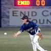 Enid's Cole Floyd tosses the ball to second during a double play against the Jenks Trojans at David Allen Memorial Ballpark Friday, March 8, 2013. (Staff Photo by BONNIE VCULEK)