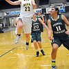 Alva's Jaden Hobbs sails pass Jamie Gibson and Carley Frymire of Thomas for a basket during the class 2A area tournament Saturday at the Chisholm Trail Expo Center. (Staff Photo by BILLY HEFTON)