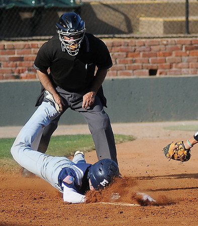 Enid's Shaun Spring slides across the plate and scores as he beats the tag by Yukon's Joe Lytle during the Gladys Winters Tournament at David Allen Memorial Ballpark Saturday, March 30, 2013. (Staff Photo by BONNIE VCULEK)