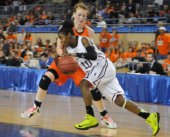 Fairview's Olivia Mason pressures T'ona Edwards of Northeast during the Lady Yellowjackets 51-35 loss to Northeast in a class 2A state semi-final game Friday at the State Fair Arena in Oklahoma City. (Staff Photo by BILLY HEFTON)