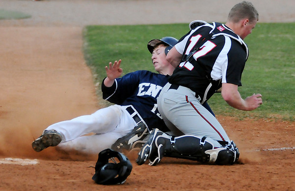 Enid's Tanner Fore scores the Plainsmen's fourth run as Tulsa Union's Charlie Rosenberger miss handles the throw to home in the bottom of the fourth inning at David Allen Memorial Ballpark. Tulsa Union won the opening game of the double-header against the Plainsmen. (Staff Photo by BONNIE VCULEK)