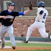 Stillwater's Will Pendleton squeezes the ball to put out Enid's Shaun Spring during the opening game of the Gladys Winters Tournament Thursday at David Allen Memorial Ballpark in Enid. (Enid News & Eagle Photo by Billy Hefton)