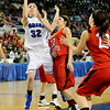 Lomega's Taylor Mendell gets around Makenzie Kelly of Erick fro a shot during their double overtime loss to Erick 56-53 in the class B state championship game Saturday at the State Fair Arena in Oklahoma City. (Staff Photo by BILLY HEFTON)