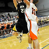 Alva's Cody Forell shoots over Merritt's Trek Rundle Monday in the class 2A consloation final at the Chisholm Trail Expo Center in Enid. (Staff Photo by BILLY HEFTON)