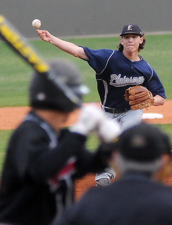 Enid's Cole Floyd pitches to Putnam City North's Garrett Perez in the top of the first inning during the Gladys Winters Festival at David Allen Memorial Ballpark Friday, March 29, 2013. (Staff Photo by BONNIE VCULEK)