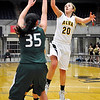 Alva's Jayna Hadwiger shoots over Ali Clayborn of Thomas during the class 2A area tournament Saturday at the Chisholm Trail Expo Center. (Staff Photo by BILLY HEFTON)