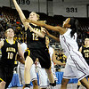 Alva's Kally Gordon drives the line against Northeast's Lanesia Williams during the Lady Bugs 53-36 loss in the class 2A championship game Saturday at the State Fair Arena in Oklahoma City. (Staff Photo by BILLY HEFTON)