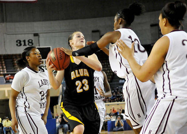 Alva's Jaden Hobbs is confronted by by Northeast's Jaelyn Coleman, T'ona and Chanel Akins as she drives the lane during the Lady Bugs 53-36 loss in the class 2A championship game Saturday at the State Fair Arena in Oklahoma City. (Staff Photo by BILLY HEFTON)