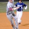 Jenk's third baseman cannot field an overthrown ball as Enid's Jake Walker sprints home for the Plainsmen's first run at David Allen Memorial Ballpark Friday, March 8, 2013. (Staff Photo by BONNIE VCULEK)