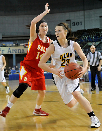 Alva's Jaden Hobbs drives around Dale's Brayden Newton Saturday during the Lady Bugs 57-47 win in a class 2A semi-final game at the State Fair Arena in Oklahoma City. (Staff Photo by BILLY HEFTON)
