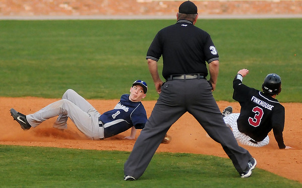 Enid's Zayne Herbel slides past second base as he attempts a tag on Putnam City North's Connor Finkhouse during the Gladys Winters Festival at David Allen Memorial Ballpark Friday, March 29, 2013. (Staff Photo by BONNIE VCULEK)