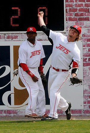 NOC-Enid's Korbin Polston catches the ball off the center field wall and throws it toward second Saturday, March 16, 2013. (Staff Photo by BONNIE VCULEK)