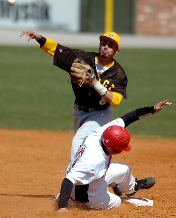 NOC-Enid's Aaron McCandless tries to break up a double play by sliding into Dodge City's Jarren Donato Tuesday at David Allen memorial Ballpark. (Staff Photo by BILLY HEFTON)