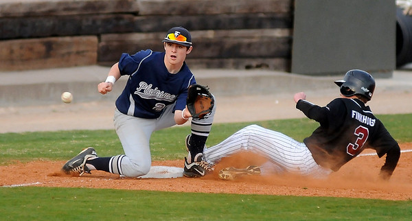 Enid's Braden Rogers waits for the throw as Putnam City North's Connor Finkhouse slides safely into third during the Gladys Winters Festival at David Allen Memorial Ballpark Friday, March 29, 2013. (Staff Photo by BONNIE VCULEK)