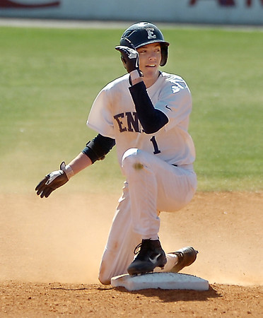 Enid's Zayne Herbel looks toward the dugout after safely sliding into second base against the OKC Broncos Monday at David Allen Memorial Ballpark. (Staff Photo by BILLY HEFTON)