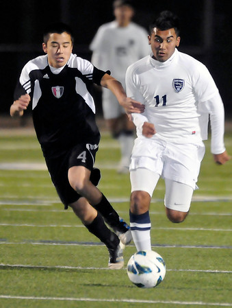 Enid's Felix Mora out races a Tulsa Union defender to the ball Tuesday at D. Bruce Selby Stadium. (Staff Photo by BILLY HEFTON)