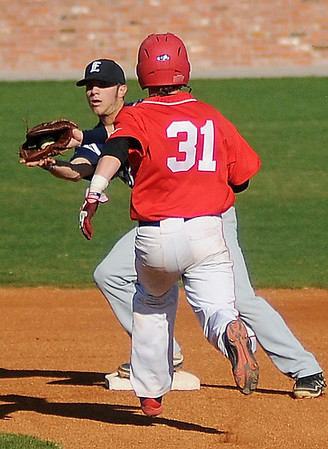 Enid's Jake Walker makes the catch for an out at second against Yukon's Will Pickens during the Gladys Winters Tournament at David Allen Memorial Ballpark Saturday, March 30, 2013. (Staff Photo by BONNIE VCULEK)