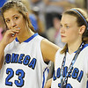 Beca Drake(left) and Charity Geis as Lomega receives their runner-up medal after a double overtime loss to Erick 56-53  in the class B state championship game Saturday at the State Fair Arena in Oklahoma City. (Staff Photo by BILLY HEFTON)