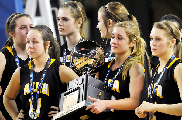 Members of the Alva Lady Bugs watch as the Northeast Lady Vikings receive their championship medals after defeating Alva 53-36 in the class 2A finals Saturday at the State Fair Arena in Oklahoma City. (Staff Photo by BILLY HEFTON)
