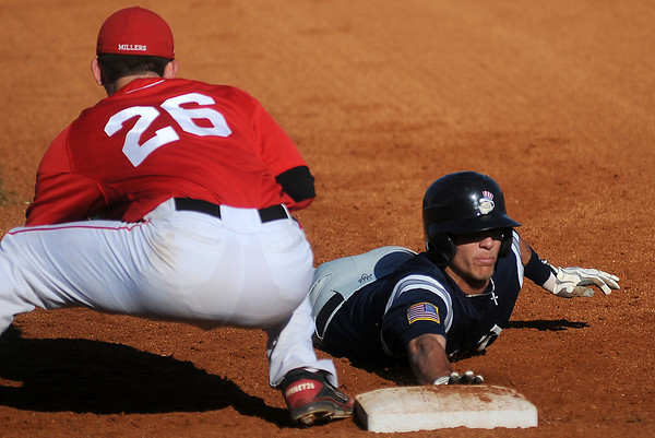 Enid's Jake Walker (right) slides safely back to first against Yukon's Jon Denney during the Gladys Winters Tournament at David Allen Memorial Ballpark Saturday, March 30, 2013. (Staff Photo by BONNIE VCULEK)