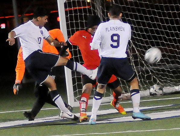 Enid's Oscar Pena takes a shot on goal for the Plainsmen's first score against Del City at D. Bruce Selby Stadium Friday, March 8, 2013. (Staff Photo by BONNIE VCULEK)
