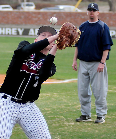 Putnam City North's Carson James attempts a catch in foul territory near the Panthers' dugout at David Allen Memorial Ballpark Friday, March 29, 2013. (Staff Photo by BONNIE VCULEK)
